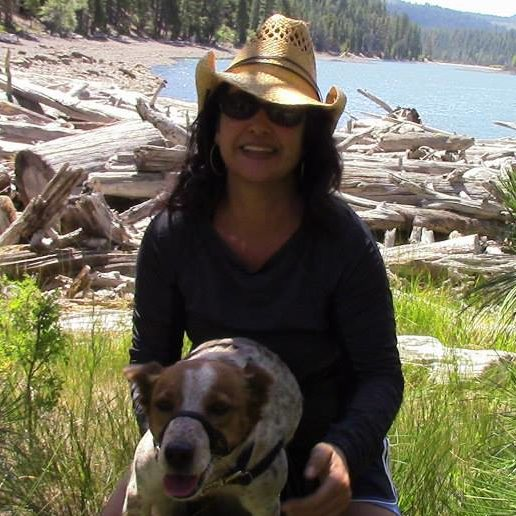 Aja Couchois Duncan author photo with dog outdoors by a lakeshore