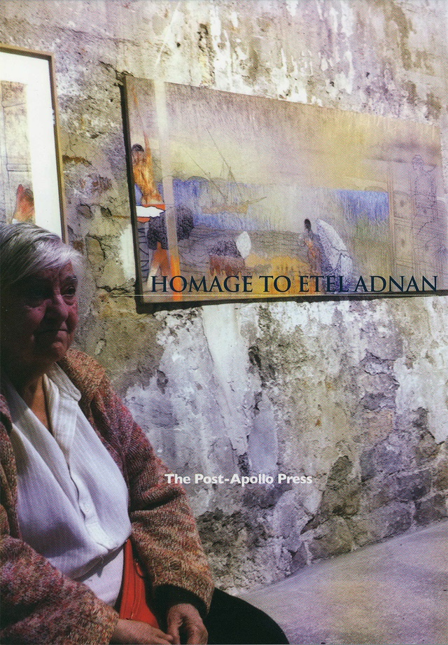 "Etel Adnan sitting in front of a painting on the wall with the words ""homage to etel adnan"" in the middle"