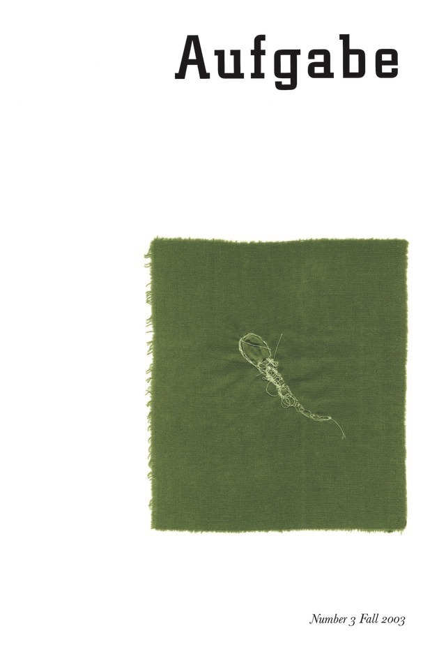 cover for Afugabe Number 3, Fall 2003. White background with the image of a square piece of camo green fabric. A tadpole is embroidered into the center of the fabric square with light green, almost white thread.