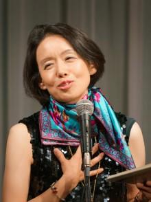 takako arai speaking into mic