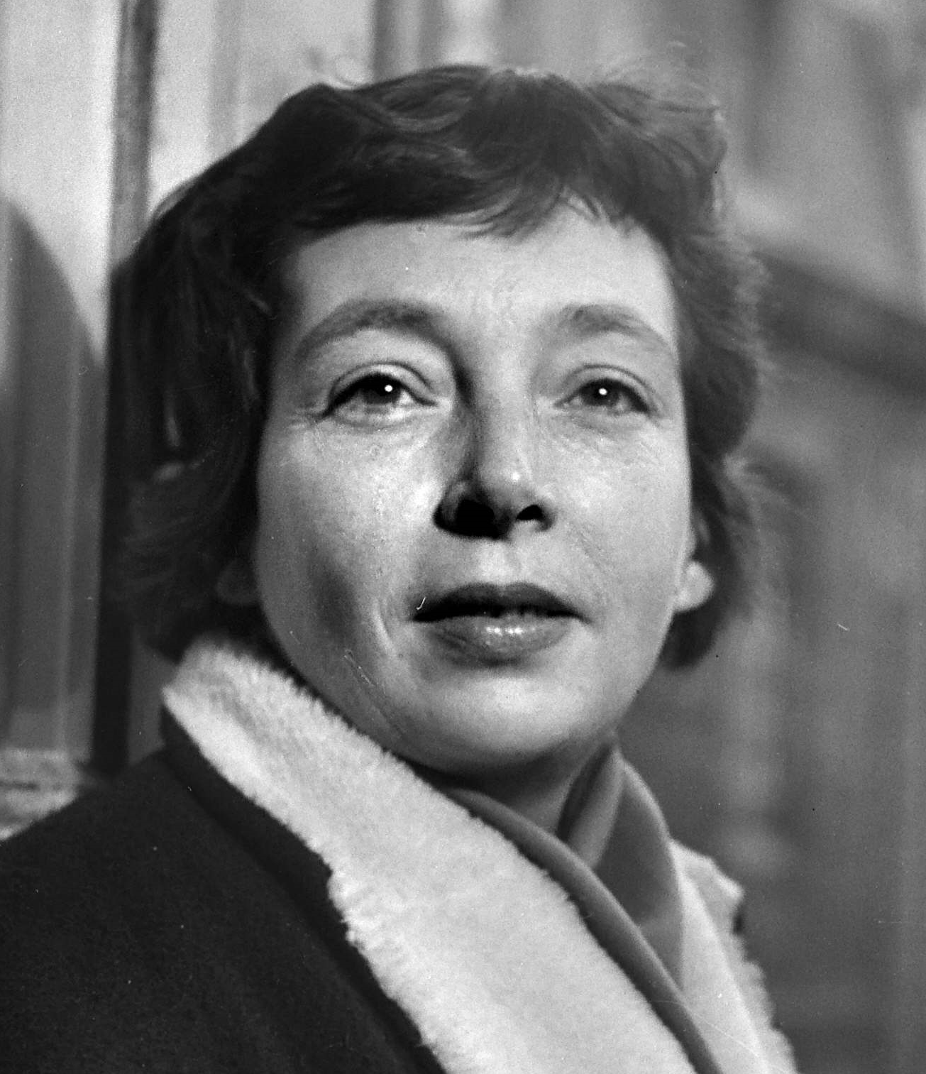 marguerite duras contributor photo, b&w close-up, leaning against blurred grey wall