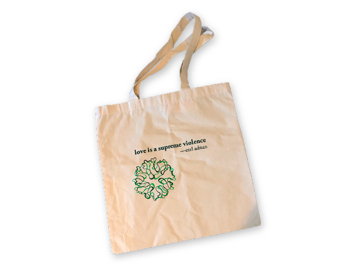 """white Etel Adnan Tote with Litmus logo and adnan quote: """"love is a supreme violence"""""""