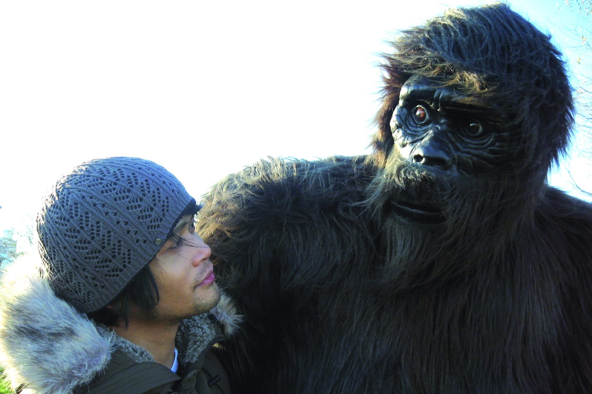 Paolo Javier contributor photo, outdoors, beside someone dressed in a realistic ape costumeape