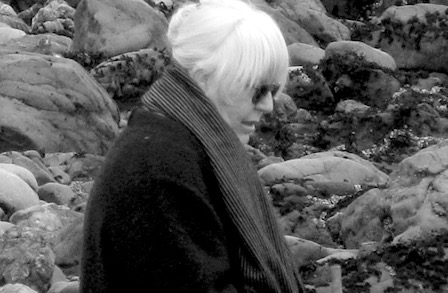 Joanne Kyger contributor photo, b&w outdoors, in front of smooth rocks