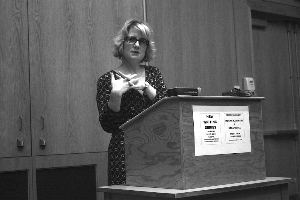jennifer moxley contributor photo, b&w, speaking at a podium