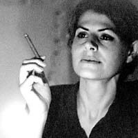 Eleni Sikelianos contributor photo, b&w and smoking a cigarette