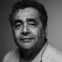 Habib Tengour contributor photo, b&w close-up with grey background